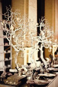 """""""Branches strung with dried wood flowers, feathers and glass bulbs"""""""