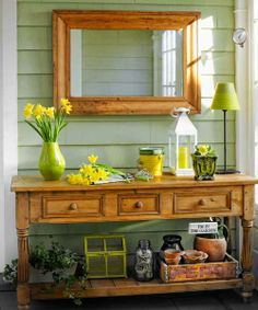 Cool green and a well-styled vignette make this breezeway feel more like a room than a transitional space. | Photo: Tria Giovan