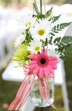 Pink and white florals for wedding aisle decor #flowers #daisies #decor  Photo by: Anna K Photography on Heart Love Weddings