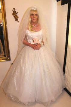 The main crossdressing room at my crossdressing service is full of wedding dresses, ball gowns and party dresses any girl would be proud to wear. Nigella is having the time of her life. x