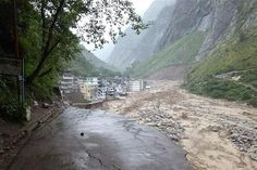 In this handout photograph released by The Indian Army on June 18, 2013, floodwaters of the River Alaknanda pass by the debris of a shattered roadway in Chamoli district in the northern Indian state of Uttarakhand on June 18, 2013. Posted by floodlist.com #floods #uttarakhand