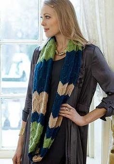 This cowl displays ripples in stripes of color, resulting in interesting textures any way you wear it. Shown in Patons Lace Sequin.