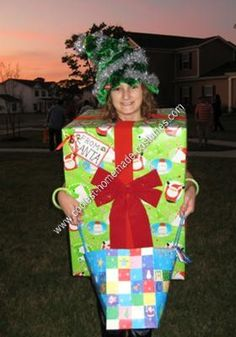 Homemade Christmas Present Under the Tree Costume: My daughter, Sierra, does not do gory, gross or scary. In fact, she won't even stay in the same room if someone is talking about blood, guts or gore. Halloween