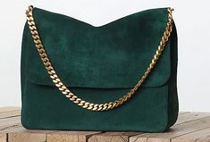 Making you rethinking your Chanel quilted obsession? Céline Gourmette in emerald suede