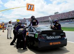 Denny Hamlin climbs out of his car to swap spots with Brian Vickers during a pit stop. Talladega - May 5, 2013