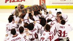 pThe Dubuque Fighting Saints celebrate with the Clark Cup on Friday night. Frankie DiChiaras goal in overtime gave the Saints a 3-2 victory over Fargo and a three-game series sweep./p