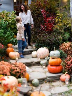 Tiered pumpkins on front walkway | Better Homes & Gardens