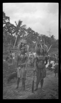 Portrait of two men wearing traditional Samoan clothing and ornaments. Creator/Contributor:Lambert, Sylvester Maxwell, 1882-1947, Photographer Date:between 1919 and 1939 Contributing Institution: UC San Diego, Mandeville Special Collections Library