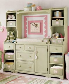 how cute! Old entertainment center repurposed into a baby storage / changing table (inspiration)