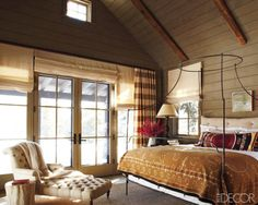 love the rustic chic - mix/match of the tufted settee with the tree-trunk side table, the simple patterns in the fabrics...don't love the birdcage poster bed, but other than that, this is great