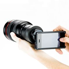 The iPhone SLR Mount. Yes, it's really real. (this whole website has the most ridiculously cool accessories for both dslr and smartphone/iphone cameras.)