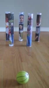 Ball directional play with paper towel tubes and pictures of family or friends.  Love this so creative