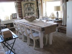 Butcher block table, cupboard filled with ironstone and other whites