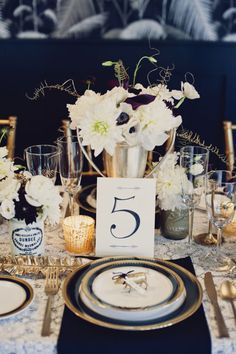 Glamourous black and gold #placesetting #tablenumber | Photography: khakibedfordweddings.com | Floral Design: www.facebook.com/JonicaMooreStudio