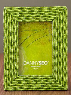 Danny Seo Beaded Frame In the color of the season, and such an easy way to layer in a little texture. $12. homegoods.com.