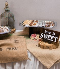 Burlap bags instead of fabric to decorate this dessert table.