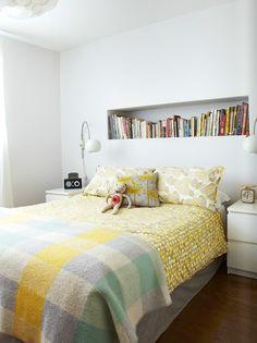 bookshelf over bed