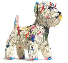 Dog sculptures made from upcycled plastic toy parts.