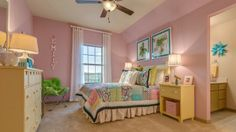 The #homes at Bridges of Las Colinas offer spacious #bedrooms with attached #bathrooms, which adds a little independence to this darling #pink #girls #bedroom.