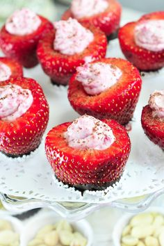 Strawberry cups dipped in chocolate and filled with raspberry mascarpone cheese.  Easy and delicious!