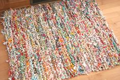 Crazy Mom Quilts is known for her great tutorials, like this crocheted rug made from old T-shirts a few years back. Her latest tutorial shows us how to knit a rag rug using fabric scraps. Isn't it cute?