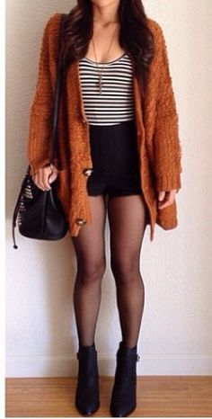 Fall/Winter Outfit Inspiration tan/orange sweater tank top black shorts/skirt stockings booties long bulky necklace oversized purse