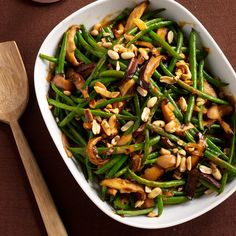 Green Bean Casserole with Red Curry and Peanuts | Store-bought red curry paste and coconut milk put a Thai spin on this green-bean-and-mushroom holiday classic.
