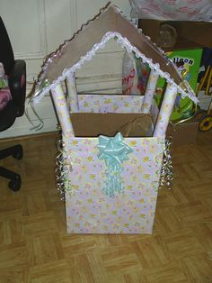 DIY shower wishing well with wrapping paper rolls...