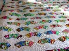 Fan quilting pattern and feather quilting.