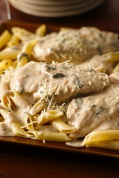 Chicken, pasta and Parmesan basil cooking sauce make an easy weeknight dinner!