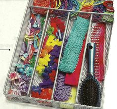 Use an inexpensive kitchen utensil organizer to give hair accessories their own place