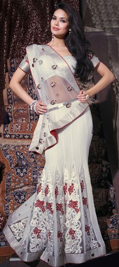 Searching an elegant look but in #traditional wear? Go for A-line Lehenga. #white color makes it look more sensuous.     code:81149
