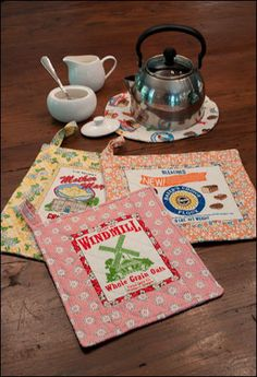 """""""Retro Spin Hotpads."""" Web bonus for Ann M. Wanke's placemat project featured in Quilt Almanac 2012. Fabric used was from the Floursack collection by Ann M. Wanke for Windham Fabrics."""