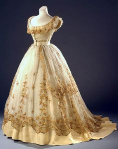 "Front-closing Ballgown ca. 1865. ""The straw embroidery on this dress makes it particularly spectacular worn over a crinoline,"" says Europeana blog about photo (by Christa Losta), from the Vienna Museum. (couldn't find the original photo at the Wein Museum)"