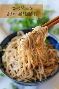 Sesame Soba Noodles 8 ounces soba 1/4 cup rice wine vinegar 2 tablespoons soy sauce 1 tablespoon sesame oil 1 tablespoon sugar 1 clove garlic, pressed 1 teaspoon grated ginger 2 green onions, thinly sliced 2 tablespoons chopped fresh cilantro leaves 1 teaspoon sesame seeds 2 hard boiled eggs, sliced lengthwise, for serving