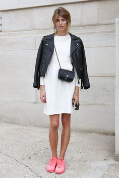 Please note: she's wearing NIKES with her little white dress and moto jacket #streetstyle