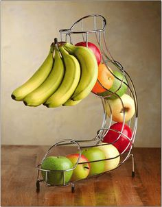 Countertop Fruit Dispenser.  Great Organization instead of lying all over the counter.
