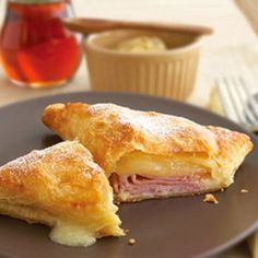Baked Monte Cristo Sandwiches. Simple recipe, easy to make. Used sprinkle cheese instead of slices, and melted butter instead of egg (got less brown on top). Also left off the sweet part (no sugar dusting or syrup). Easy lunch to make ahead of time.