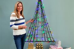 Wall tree  If you are thinking about a great modern way to decorate this christmas you have come to the right place.  In this video I will show you how to make a wall tree using only Christmas lights, a few baubles and Command clear hooks.   Such a wonderful alternative to a traditional tree and perfect if you are short on space.