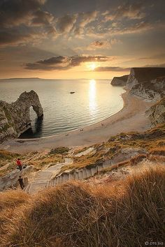 Autumn Sunset. Looking west from Durdle Door on Dorset's Jurassic Coast, England.