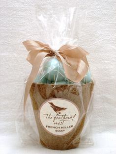 Beautiful ROBINS EGG BLUE speckled egg shaped soap packaged in a peat pot. $7.95, via Etsy.