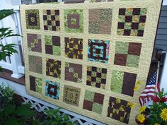Same quilt idea but with beige sashing and borders. Just to give you an idea of a non-white design.  :)  The blocks are a little darker and use more chocolate brown because the borders were darker. earthi quilt, quilt idea