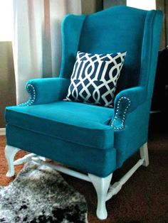 PAINTED Upholstered Chair  Kristy from Hyphen Interiors used a mixture of water, fabric medium and latex paint to give this old wingback chair a facelift. After the fabric was painted, she hit the wood legs with a couple coats of glossy white for glam modern look.