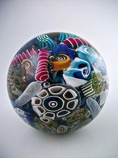 "Art-glass paperweight entitled ""Ocean Reef Paperweight Sphere,"" created by Michael Egan"