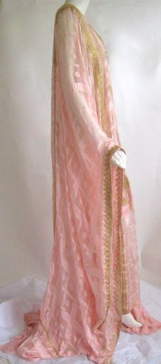 Exceptional pink silk caftan that dates to the 1920s  Brocaded semi sheer silk Slight train in back Decorated with gold chain stitch embroidery and tiny gold sequins, Art Deco period