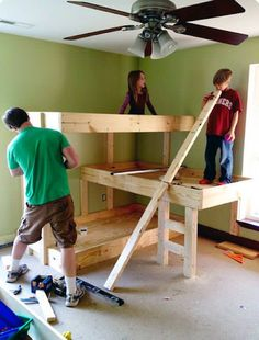 DIY Three-Level Bunk Beds. OR no bottom bunk, use the area as an office, shelf under the second level overhang thingy, then bed on the second level, and a loft area with bean bags and stuff on top!!!