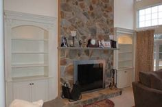 built in bookcases with stone fireplace