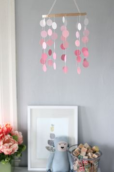 DIY: paint chip mobile – I did a variation of this with scalloped circles and I also ruffled some burlap to cover the hoop.  The stitching through the paint chips isn't too cute, but I'm using it as a photo prop, so it doesn't have to be perfect.  All in all, me likey.