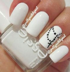 Love it . White nails with a little cross