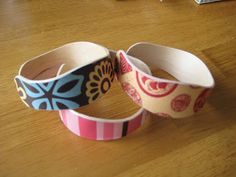 Make your own bracelet! Boil Popsicle sticks for 15 minutes. Then place into a cup to dry in a circle. Can use any cup size you'd like. Once dry, paint, decoupage, glitter, paper. You get the idea. VERY CUTE!